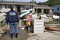 FEMA - 31793 - FEMA worker looks at a flood damaged home in Minnesota.jpg
