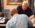 FEMA - 44197 - A FEMA worker helps a resident at a Disaster Recovery Center in Nashville.jpg
