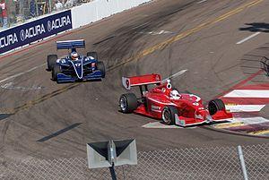 Anders Krohn - Krohn (red car) driving in Indy Lights for Belardi Auto Racing at St. Petersburg in 2011