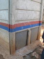 Faeces vault doors of a urine-diverting dry toilet (UDDT) in low-income area Bulbul near Nairobi, Kenya (10543475753).jpg
