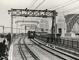 First passenger train crossing the Sydney Harbour bridge, 19 March 1932.
