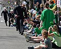 Flickr - Official U.S. Navy Imagery - A Sailor shakes hands with spectators during the 111th annual St. Patrick's Day parade..jpg