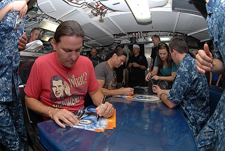Shawn Drover and Chris Broderick sign autographs aboard the Los Angeles-class attack submarine USS Helena (SSN-725). Flickr - Official U.S. Navy Imagery - Shawn Drover and Chris Broderick, members of the band Megadeth, sign autographs in the crew mess aboard USS Helena.jpg