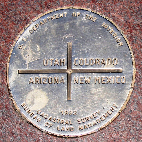 Apache County includes the Arizona section of the Four Corners Monument. Four Corners marker, southwestern United States.jpg