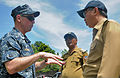 From left, U.S. Navy Capt. James Morgan, the Pacific Partnership 2012 mission commander, speaks with Vice Regent Piet H. Kuera, center, and Regent Toni Supit on the island of Siau in North Sulawesi, Indonesia 120605-N-GI544-351.jpg