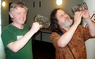 "Gratis versus libre - Richard Stallman (right) illustrating his famous sentence ""free as in free speech not as in free beer"", with a beer glass. Brussels, RMLL, 9 July 2013"