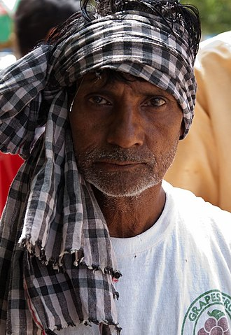 Gamucha - A fruit vendor wearing a gamchha tied as a headscarf.