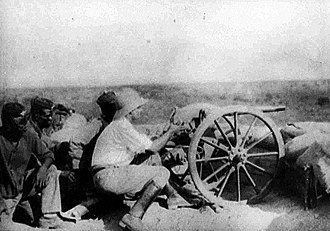 First Battle of Garua - A German officer fires a gun from the defences at Garua during the Kamerun Campaign