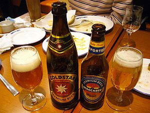 """Beer in Israel - Israeli commercial beers """"Goldstar"""" and """"Maccabee"""" (with bottle labels in English for export), produced by Tempo Beer Industries Ltd."""