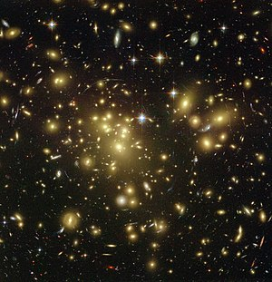 Dark matter - Strong gravitational lensing as observed by the Hubble Space Telescope in Abell 1689 indicates the presence of dark matter—enlarge the image to see the lensing arcs.