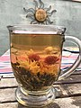 Green tea with blossoming flower.jpg