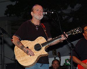 Photo of musician Gregg Allman in concert.