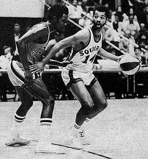 Harold Fox (basketball) - Fox (left) guarding Roland Taylor (right)
