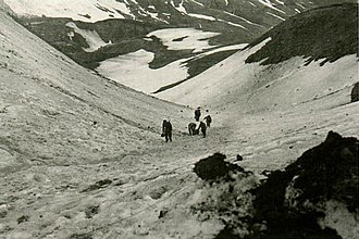 Aleutian Islands Campaign - American troops hauling supplies on Attu in May 1943 through Jarmin pass. Their vehicles could not move across the island's rugged terrain.