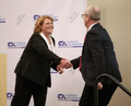 Heidi Heitkamp and Kevin Cramer greet each other during debate for the 2018 Senate's election.png