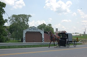 Paradise Township, Lancaster County, Pennsylvania - Herr's Mill Covered Bridge and an Amish buggy in Paradise Township