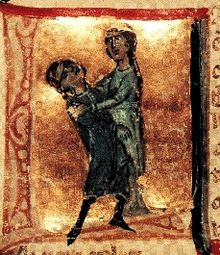A lady holding a man in her arms