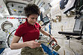 ISS-43 Samantha Cristoforetti unpacks scientific equipment.jpg