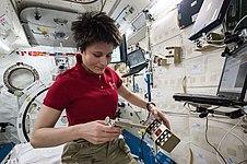 ISS-43 Samantha Cristoforetti unpacks scientific equipment.jpg