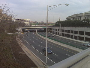 Interstate 83 - Jones Falls Expressway from Saint Paul Street's bridge.  The Baltimore Penn Station is the large building to the right.