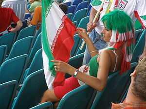 Football in Iran - A female fan of Iran national football team, watching the match against Angola