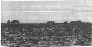 Evangelistas Islets - Photo of the islets by George Henry Slight, the arrow indicating the site of the lighthouse