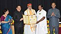 J.P. Nadda presenting the National Florence Nightingale Award to Smt. Vrundamma, Auxiliary Nurse Midwife (ANM), Primary Health Center, Kailancha Ramanagara district Karnataka, on the occasion of the International Nurses Day.JPG
