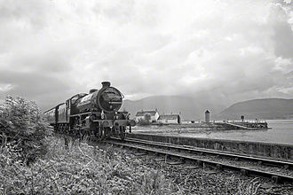 The Jacobite (steam train) - The Jacobite, 62005 Lord of the Isles, passes the Corpach Sea Lock