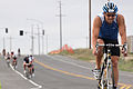Jon Wieman pulls ahead of a group of competitors during the 56-mile bike ride through Marine Corps Base Camp Pendleton during the Ironman 70 130330-M-LD192-564.jpg