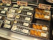 Makizushi selection (Futomaki and Inarizushi at right) from a Kansai Super store.
