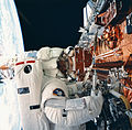 Kathryn Thornton replacing the solar arrays of the Hubble space telescope during the STS-61 mission 9400261.jpg