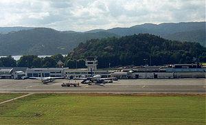 Kristiansand Airport, Kjevik - A Norwegian Air Shuttle Fokker 50 and a Scandinavian Airlines Boeing 737 at Kjevik in 1999