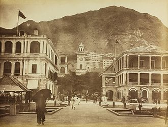 Dent & Co. - Dent Building (left) and the first generation Jardine House (right), with Pedder Street Clock Tower in the background. 1886 photograph by Lai Afong.