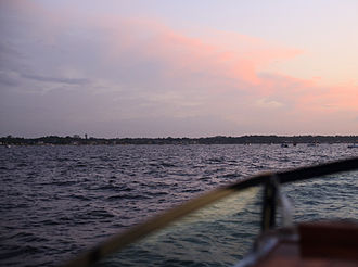 Lake Conroe - Significant boat traffic at dusk on Independence Day.