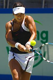 Li Na hitting a two-handed backhand.