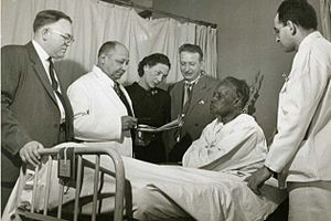 Louis T. Wright - Louis T. Wright and colleagues at patient bedside, Harlem Hospital, New York, N.Y. From left to right: Dr. Lyndon M. Hill, Dr. Louis T. Wright, Dr. Myra Logan, Dr. Aaron Prigot, unidentified African American woman patient, and unidentified hospital employee.