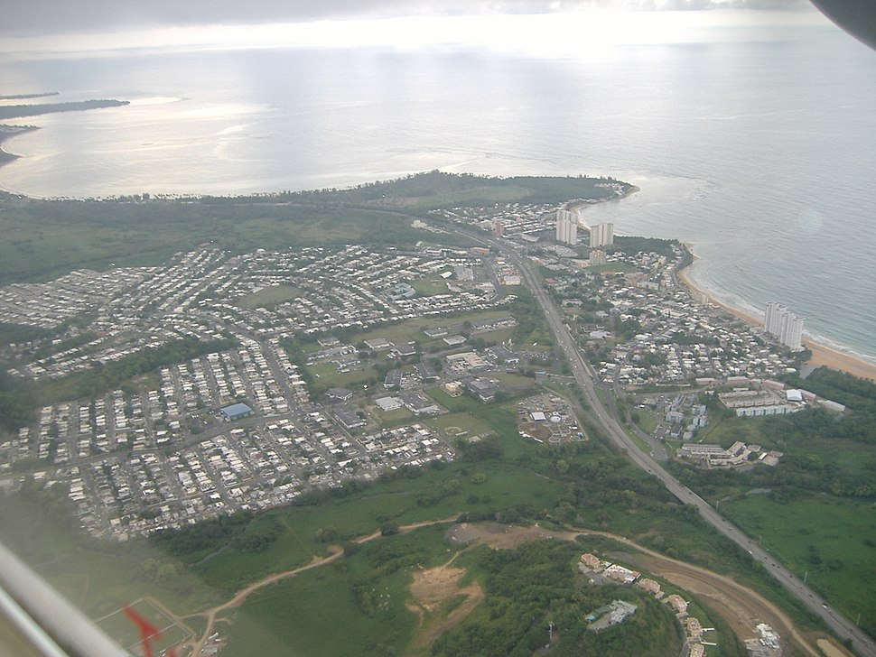 Aerial view of a coastal city from inland