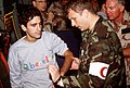 MAJ. Brian Carney, A U.S. Air Force orthopedics surgeon, examines CAPT. Cocciolone, an Italian military officer held prisoner by Iraqi forces during Operation Desert Storm. Cocciolo - DPLA - 43b1d015899576fb8c5c1e96e6f5e984.jpeg