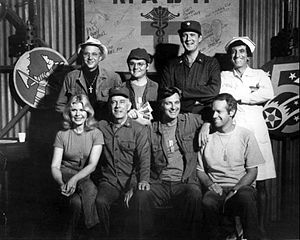Jamie Farr - Cast of M*A*S*H (TV series) (1977); back row, L-R: William Christopher, Gary Burghoff, David Ogden Stiers, and Jamie Farr Front: Loretta Swit, Harry Morgan, Alan Alda, Mike Farrell
