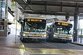 MBTA route 32 and 42 buses at Forest Hills lower busway, June 2017.jpg