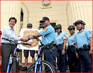 Manila Police District - DOT Secretary Alberto Lim turns over to PSRINSP Jovan Sicat twenty (20) bikes for the use of the Manila Police District Tourist Police.