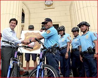 Manila Police District - DOT Secretary Alberto Lim turns over to PSRINSP Jovan Sicat twenty (20) bikes for the use of the Manila Police District Tourist Police.