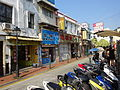 Macau 告利雅施利華街 Rua Correia da Silva Oct-2015 DSC motorbike carpark n shops.JPG