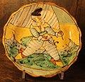 Maiolica di montelupo, piatto con figura che regge una bandiera, 1620-40 ca..JPG