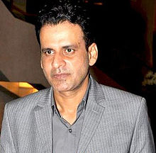 Manoj Bajpai is looking away from the camera.
