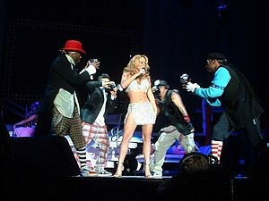 "Heartbreaker (Mariah Carey song) - Carey and her dancers performing ""Heartbreaker"" on the Charmbracelet Tour in 2003"