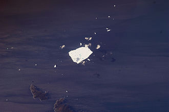Petermann Glacier - Astronauts on the International Space Station used a digital camera to capture this view of Petermann Ice Island A, fragment 2, off of the north-east coast of Newfoundland.