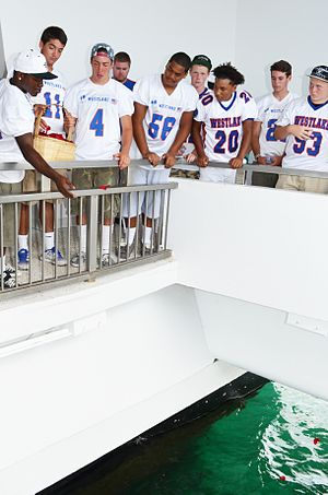 Westlake High School (California) - California's Westlake High School Football Team players drop flower petals in the water in honor of Lt. j.g. Francis L. Toner IV and Spc. A.J. Castro during a memorial held at the USS Arizona Memorial. Toner and Castro, graduates of Westlake, died during Operation Enduring Freedom