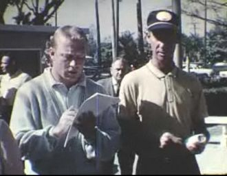 Mickey Mantle - Mantle (left) in the early 1960s signing an autograph