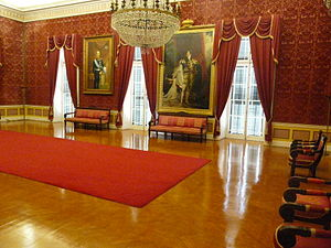 Palace of St. Michael and St. George - The Throne Room, which contains a copy of Sir Thomas Lawrence's portrait of King George IV of Great Britain and Ireland (the portrait on the right of the above photograph) and the portrait of King George I of Greece (the portrait on the left side).